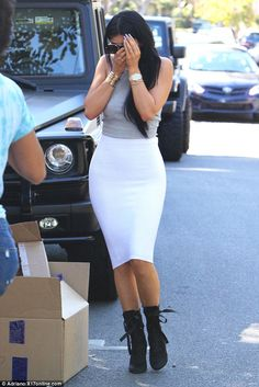 Spitting image: The 17-year-old was wearing a grey crop top, white pencil skirt and high heeled boots, the very same style frequently worn by Kim