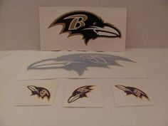 """BALTIMORE RAVENS (NFL) / 2013 SUPER BOWL CHAMPIONS - 1 RAVENS Sticker Sheet (approx. 3 1/2"""" x 7"""") / 1 - RAVENS Window Decal (approx. 4"""" x 8"""") / 3 - RAVENS Temporary Tattoos (approx. 2"""" x 2"""" each) / 1 - RAY LEWIS Trading CARD (My Choice - Company and Year) eaglecollector83,http://www.amazon.com/dp/B00BAN6DSY/ref=cm_sw_r_pi_dp_vqkdtb06G8EGY52M"""