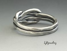 Silver knot Ring, Love Knot Ring, Infinity Knot Ring, Sailors Knot, Eternity Knot ring, Silver Eternity Ring Unique forged sailors knot ring made of 12 gauge (2 mm) sterling silver wire. The ring has been oxidized to darken in between the wires and create a beautiful contrast with the