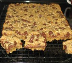 Chocolate Peanut Butter Bars 2 cups quick-cooking oats 1 3/4 cups firmly packed light brown sugar 1 1/2 cups All Purpose Flour 1 teaspoon baking powder 1/2 teaspoon baking soda 1 cup butter 1/2 cup chopped peanuts 1 cup (6 oz. pkg.) semi-sweet chocolate chips 1 large egg, beaten 1 (14 oz.) can Sweetened Condensed Milk 1/2 cup Creamy Peanut Butter