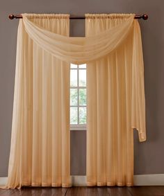 """Warm Home Designs extra wide Taupe curtains have total width of 112 inches. 2 panels (1 pair) is included in a package. Rod pocket insert will fit most rods up to 2"""" in diameter. Scarf length is 216"""". Both scarf and curtain sheers are made from high-quality polyester and are designed to let most of the sun light through while offering some privacy at night."""