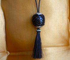 Turk's Head Pendant like no other.  Kangaroo leather with horsehair tassel.   Handcrafted with skill and pride. on Etsy, $40.00