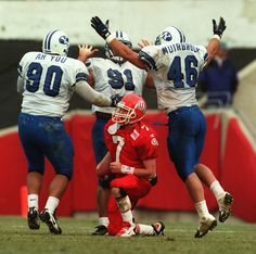 BYU players celebrate a sack of Utah quarterback Mike Fouts in the 1996 rivalry game. (Rick Egan  |  The Salt Lake Tribune)