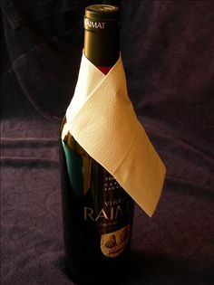 Napkin/Serviette  Folded for Bottle Service from Food.com:   Super easy and works very well indeed with both cloth or paper serviettes/napkins.  This very basic fold transforms the naked neck of your wine bottles into something elegant and also catches drips. I have included step by step photographs to illustrate / suppiment my written instructions. This fold works best with a smaller napkin and I almost always find that paper ones are the easiest.