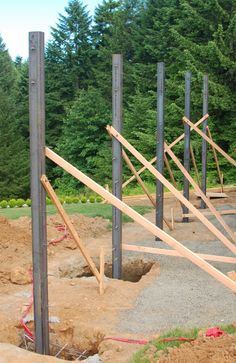 Time flies when you're… waiting for construction progress. House Foundation, Building Foundation, Steel Frame House, Steel House, Interlocking Concrete Blocks, Deck Framing, Steel Structure Buildings, Steel Frame Construction, Garage Construction