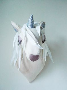 Made from cream-colored, tea-dyed fabric and a silver sequined horn, Tamar Mogendorff's unicorn head would make a whimsical addition to any little girl's room.