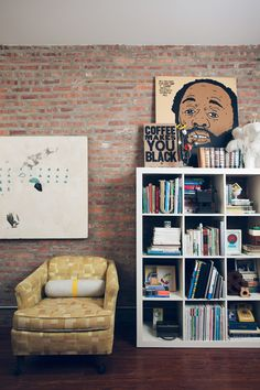 love the exposed brick and art displayed at varying heights