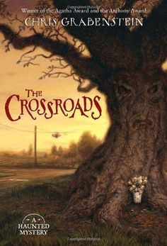 The Crossroads (A Haunted Mystery) by Chris Grabenstein https://www.amazon.com/dp/0375846980/ref=cm_sw_r_pi_dp_x_.ia-xbV011GTS