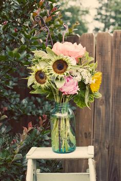 Mason jar arrangement with petal-less sunflowers, queen Anne's lace and peonies. Your budget won't allow for the peonies, but we can add an assortment of other flowers. Centerpieces.