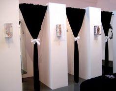 Dressing rooms....Velvet Black Curtains and white Satin Bows...(Minus the Barbie Sconces)