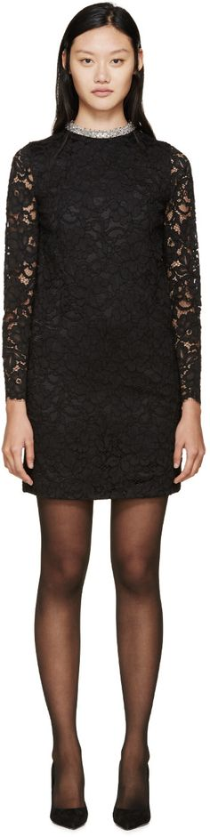 Long-sleeve floral lace dress in black. Crew neck collar featuring beading ad chain details in silver-tone. Scalloped sleeve cuffs. Concealed zipper closure at back. Partially lined. Tonal stitching.