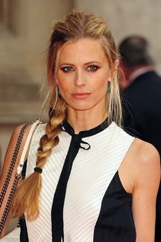 Laura Bailey collected her hair into a sleek side braid