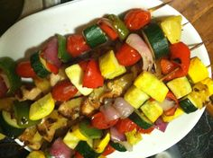 Pineapple Chicken Kabobs Marinate 1 lb chicken cubes in: 1 can pineapple chunks & juice 2tbsp soy sauce 3tbsp honey 2tbsp sunflower oil Skewer and grill Veggies: zucchini, squash, peppers, red onion Splash veggies with leftover marinade juices before grilling Serve with rice Salt n pepper