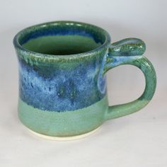 Large stoneware pottery mug with thumb rest, blue and green glaze (12 oz) by CenteredVessel on Etsy