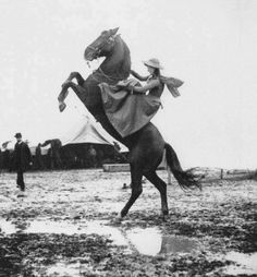Sharpshooter Annie Oakley while touring with Buffalo Bill's Wild West show, 1890.