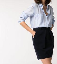 5e01217043 Minimal + Classic  light blue or denim shirt + black pencil skirt. Wrist  bangles or minimalist dark watch.