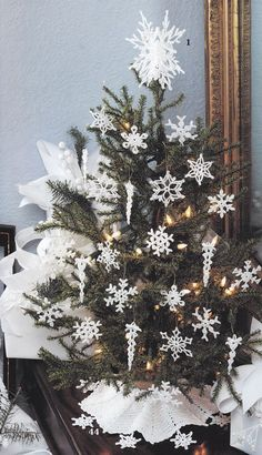 After-Christmas idea - leave the tree up, and turn it from a holiday masterpiece to a snowy wonderland by using snowflake ornaments. Can be kept up for as much of the winter as you want@