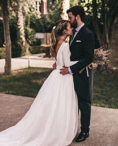 Low back, full skirt, Playful ponytail for wedding. Wedding dress. Long sleeves