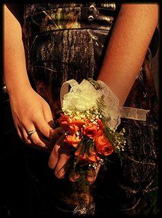 Camo dress with hunter orange tie-up back, & orange flowers. Yuuupp. Prom<3