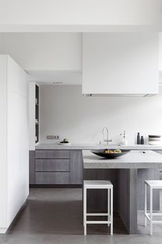 concrete floors, a very cool hued grey; would want warmer tones for cabinets to create contrast
