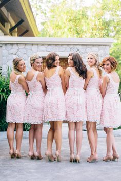 Pink and white lace bridesmaid dresses.
