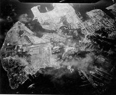 Strike photo taken by USS Hancock aircraft showing an attack on the Yokosuka Navy Yard, Tokyo Bay, Japan, 18 Jul 1945 (US National Museum of Naval Aviation)
