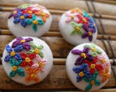 springy embroidered buttons ~ happy colors! :) Wouldn't these make ADORABLE drawer knobs too?!