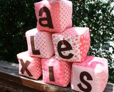 DIY Baby Blocks. These plush DIY Baby Blocks are a great toy for the little one in your life. Learn how to make baby blocks out of fabric and stuffing. Personalize this cute sewing project by spelling out your baby's name with applique letters on each block.