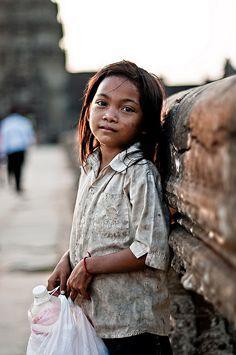 Girl collecting plastic bottles, Angkor Wat, Cambodia