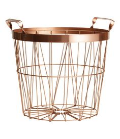 Copper-colored. Metal wire basket with handles at top. Height 9 1/2 in., diameter at top 11 in.