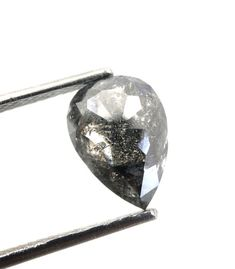 2.61Ct 10.74X7.75MM, Natural Loose Pear Rose Cut Diamond Salt And Pepper Diamond Polished Diamond Geometric Diamond Best Price Diamond J 798 DIAMOND DETAILS : TOTAL WEIGHT : 2.61Ct LENGTH : 10.74mm WIDTH : 7.75mm HEIGHT : 4.08mm COLOR : BLACK SALT AND PEPPER SHAPE : PEAR ROSE CUT