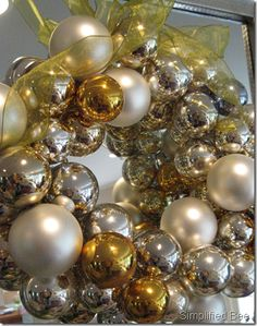 Silver and gold glass ornament wreath for Christmas mantel or door.