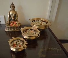 Brass Buddha Statue Of prosperity, beauty, peace and auspiciousness : Beautiful brass Buddha statue rests peacefully. The room looks adorned with different Urlis carrying flowers with everyday freshness. Take home a variety of brass home decor products. Indian Home Interior, Indian Interiors, Home Interior Design, Ethnic Home Decor, Indian Home Decor, Diwali Decorations At Home, Pooja Room Door Design, Buddha Decor, Pooja Rooms