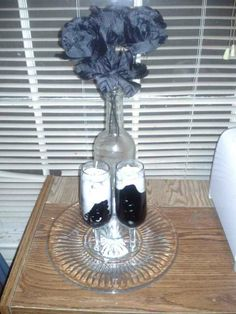 This centerpiece was made with one wine bottle and two small champagne flutes and black roses. The hand poured candles were supposed to be black, but somehow, during the pouring process, the color separated from the wax. The resulting effect was a happy accident. I do not think I could duplicate this accident, but if anyone wishes me to try, simply ask and I will attempt it ... USD $30.00 + S When Applicable http://www.thefatgrass.com/ To The Fat Grass. Thank you for your generous donations!