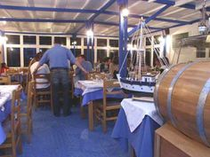 Naoussa - Awesome restaurant in Santorini - Serve you wine as you wait for your table