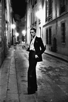 "Helmut Newton | Sirpa Lane, ""Rue Aubriot, Paris Collections,"" 1975, Vogue France, September 1975, included in the the series ""White Women,"" 1975."