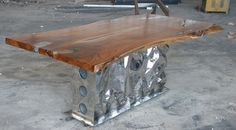 teak dining table, stainless steel leg