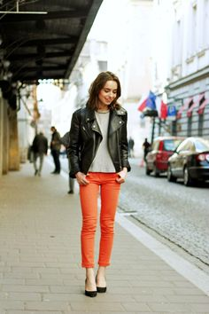 Proof a motorcycle jacket goes with everything. Love the orange cropped pants!