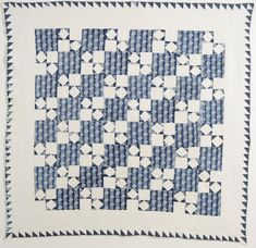Four Patch Quilt: Circa 1850; Pennsylvania. It is remarkable that a simple Four Patch quilt pattern done in just two colors can create such a complex image.