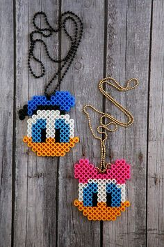 Daisy and Donald Perler Bead Necklaces - disney diy necklaces. Cute bead necklaces in the shape of disney characters. Perler Bead Designs, Easy Perler Bead Patterns, Melty Bead Patterns, Hama Beads Design, Diy Perler Beads, Perler Bead Art, Pearler Beads, Fuse Beads, Beading Patterns