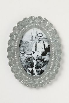 amore weathered frame from anthropologie. beautiful pressed tin. $28.00
