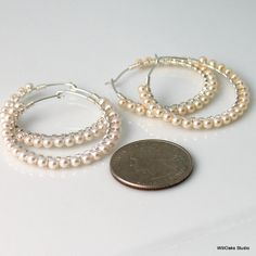 Classic, everyday and elegant, too, white Swarovski crystal pearls all around hand forged sterling silver hoop earrings. Sturdy yet dainty looking, less than 1 1/2 (37 mm) outer diameter and 1 1/8 (29 mm) inner diameter  June birthstones and never out of style, sterling hoops wrapped with fine sterling wire to capture a row of 3mm elegant Swarovski crystal pearls. Easily go from casual to business to formal. Excellent for wedding wear. Small, 3 mm pearls tightly bound all around the hoop…