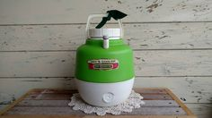 Check out this item in my Etsy shop https://www.etsy.com/listing/482430834/campy-vintage-thermos-cooler-or-vintage