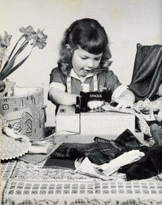 Adorable 1960s photo of a little girl sewing