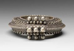 Yemen ~ Al Hudaydah ~ Beit el Faqih | One of a pair of bracelets worn by rich Jebel Milhan women, living in Tihama ~ west of Sanaa.  These types of bracelets would have been part of a woman's wedding jewels | Silver.