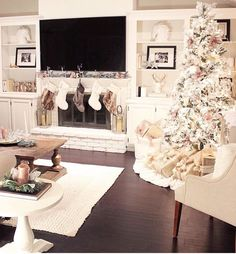 So pretty - a white indoor wonderland. And love the frames tucked into the shelving.