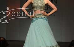 Bollywood actress Karishma Kapoor walked the ramp of LFW 2014 in a beautiful Arpita Mehta Lehenga. She looked extreme gorgeous in a blue designer lehenga embellished with mirror work around bottom with heavy embroidered sleeveless blouse.