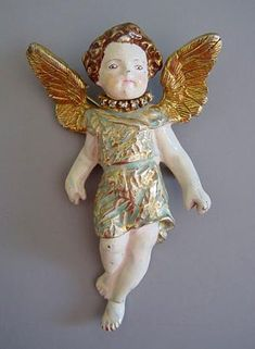 "CARNEGIE enameled cast metal angel child brooch, 4"". This is a large and heavy piece with lustrous enameling, and unlike any Carnegie I have seen before."