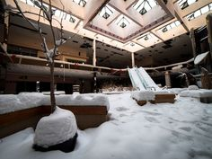 Snow falls into the abandoned Rolling Acres Mall in