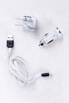 Keep your phone charger on the go with this portable charger kit from Ankit™ that includes a USB wall charger, car charger and micro USB with marble printed finish.
